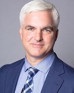 Chris J Marzke